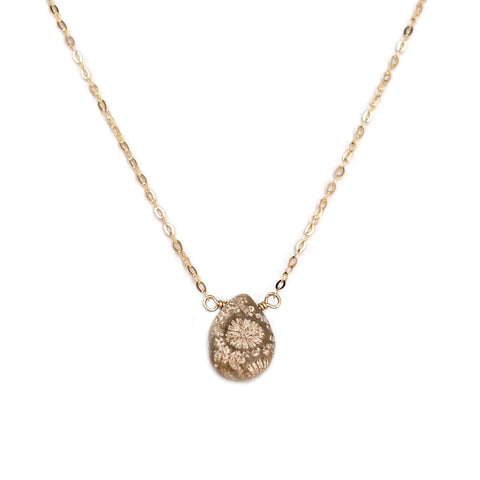 This Fossil Coral necklace is made of high quality material.  The real fossil Coral is between 225 million to 500 million years old.  We hand wire wrap with attention to detail. Using the best selected Fossil Coral and chain on this simple dainty necklace.