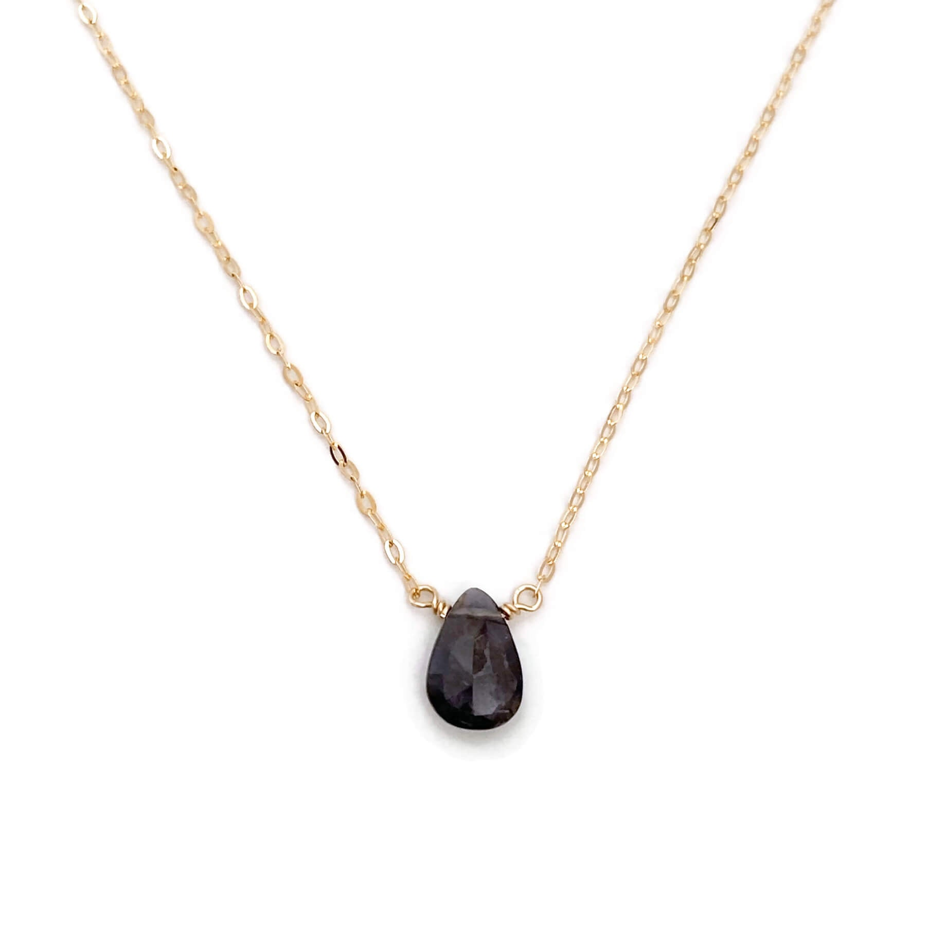 The iolite necklace is available in 14k gold, gold fill or sterling silver. This dainty purple necklace will help build strength to detoxify and help overcome bad habits.