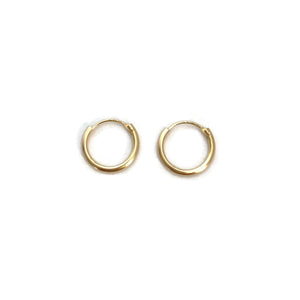 Simple gold hoop earrings are made in 14k solid gold.  They are 12mm in diameter.