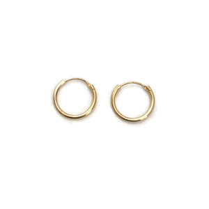 These are 14k solid gold hoop earrings. They are as light as feather and great to wear them 24/7