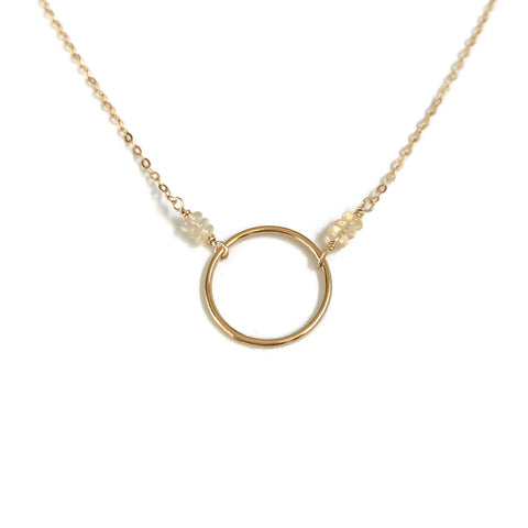 This is a opal karma circle necklace that is also a October birthstone necklace.