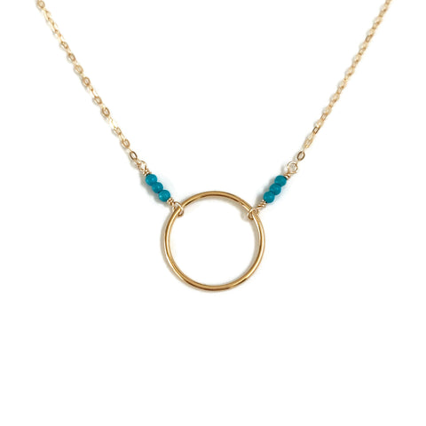 This dainty turquoise circle necklace is a minimalist turquoise necklace.
