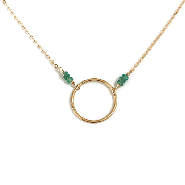 May emerald birthstone necklace features real emerald beads and gold circle necklace.