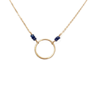 This karma circle necklace is made of genuine sapphire beads and gold filled chain.