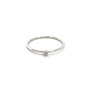 This is a cute solitaire ring that is made of sterling silver and 2mm CZ.