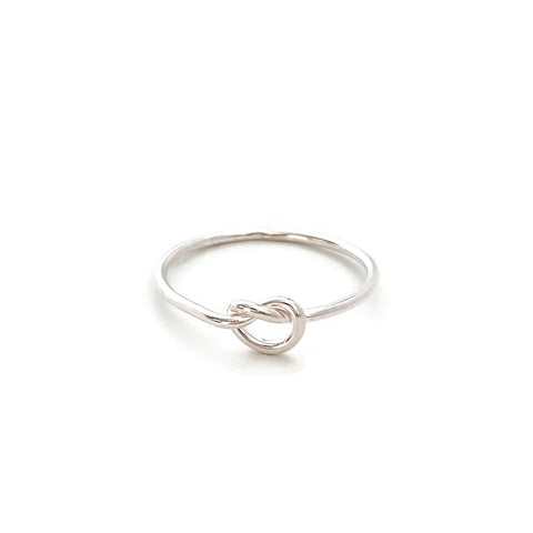 This cute sterling silver love knot ring is made of sterling silver.