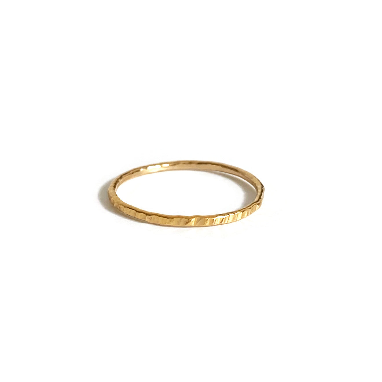 This cute dainty ring is finished with hammer texture.