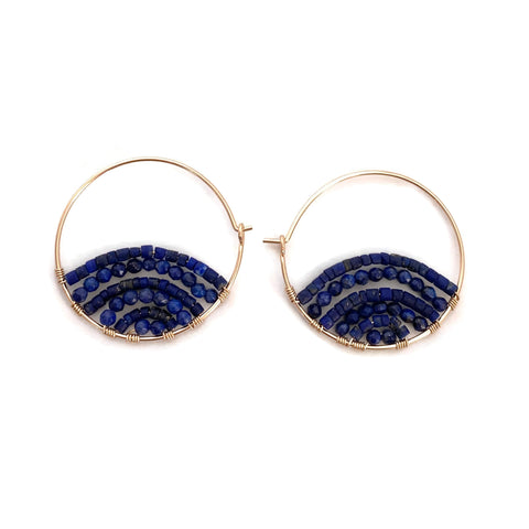 These are unique lapis lazuli hoop earrings.  We use genuine Lapis Lazuli beads to create sunrise shape within each hoop.  Each pair are  one of a kind earrings.