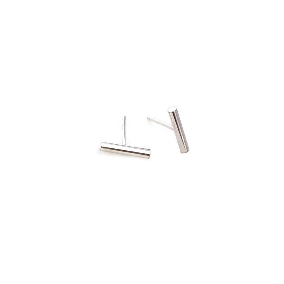 Simple bar stud earrings are made of sterling silver.