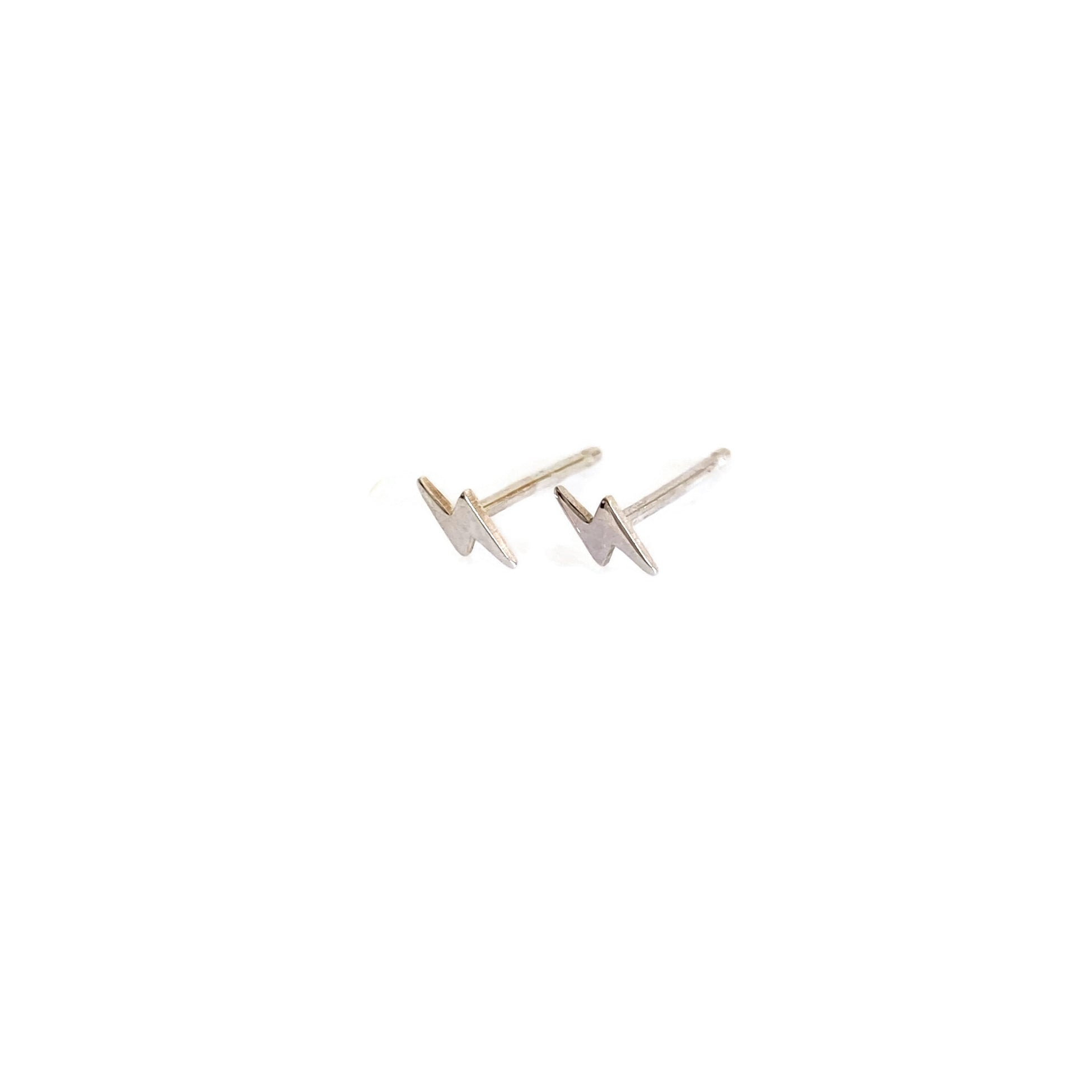 sterling silver tiny lightening bolt stud earrings are small and great for cartilage piercing.