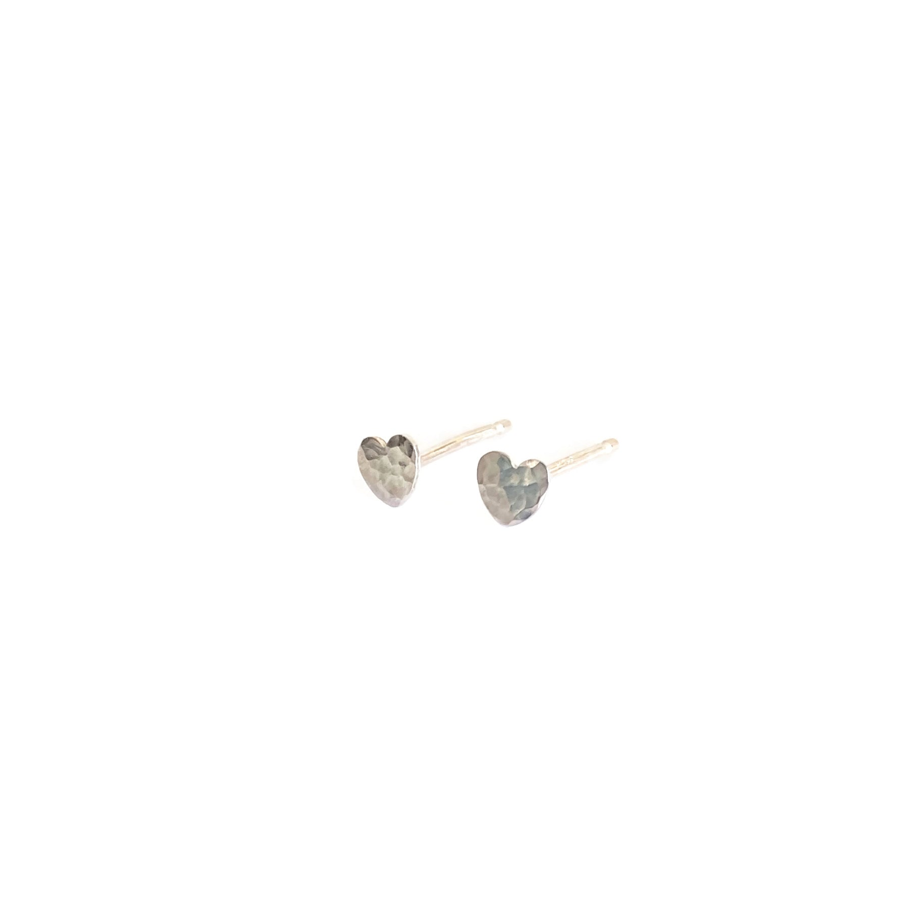 hammer texture heart earrings are made of sterling silver in San Francisco
