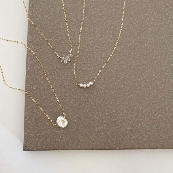 The dainty Herkimer diamond necklace can be made in 14k gold, gold filled or sterling silver chain. They are handmade in san francisco.