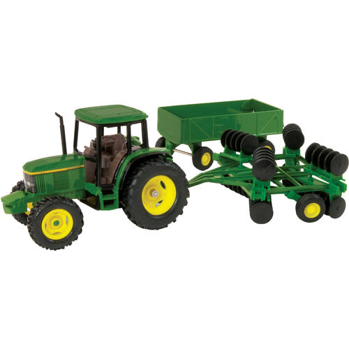 John Deere 1999 6410 with Wagon and Disk