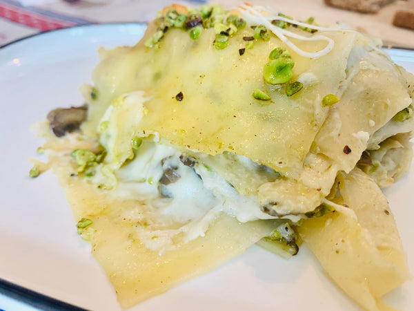 Lasagna with mushrooms, asparagus, scamorza and Bronte Pistachio