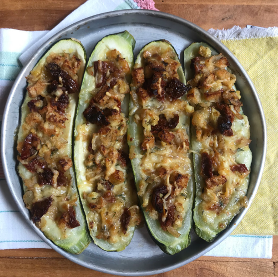 OVEN BAKED ZUCCHINI STUFFED WITH WHITE ONION, SUN-DRIED TOMATOES, CACIO CAVALLO CHEESE AND BREAD CRUMBS (X2)