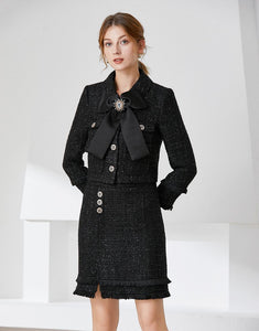 Black tweed two piece with bow and brooch
