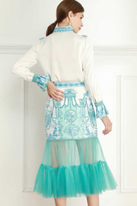 Tantalising blue dress with tulle sheer hem
