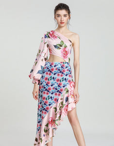 Asymmetric clashing rose print dip hem midaxi dress