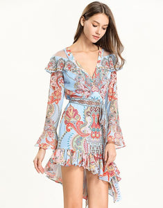 Light blue multi tile patterned mini dress with cut out shoulder.