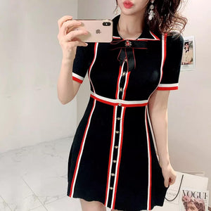 Black knitted dress with red and black stripes