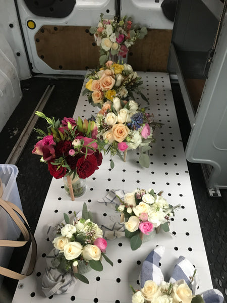 Wildroot flower delivery van filled with colorful flowers