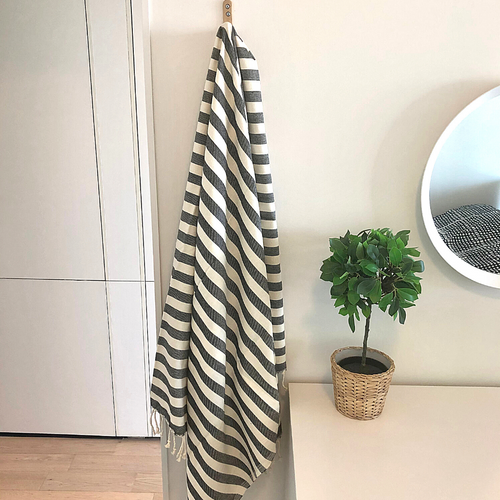 BOLD MEDITERRANEAN Turkish Towel hanging in guest room