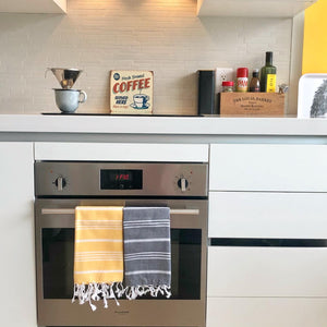 Yellow and black striped Turkish hand towels in fun modern kitchen