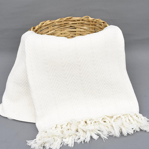 COTTON WHITE Blanket hung from woven basket