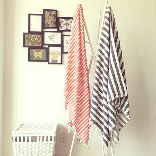 MEDITERRANEAN Turkish Towel in coral hanging in bedroom