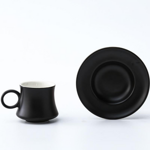 Black Turkish coffee demitasse cup and its matching saucer