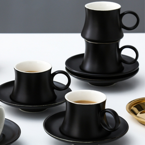 Black Turkish coffee cups with saucers
