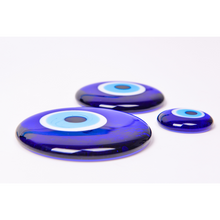 Load image into Gallery viewer, NAZAR Blue Evil Eye beads on a table