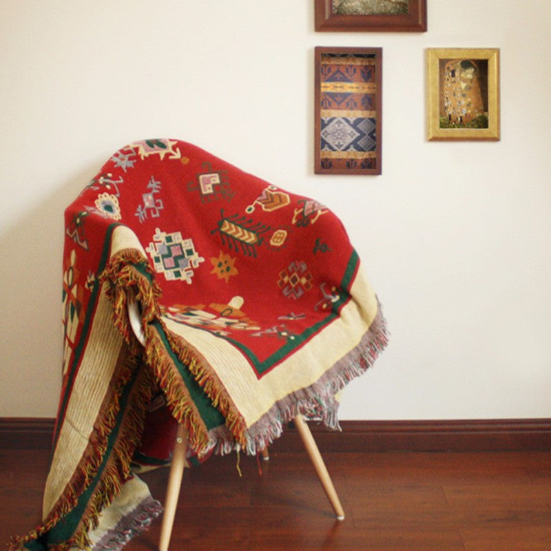 Red kilim throw on chair
