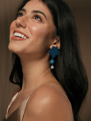 Emma wearing earrings in classic blue