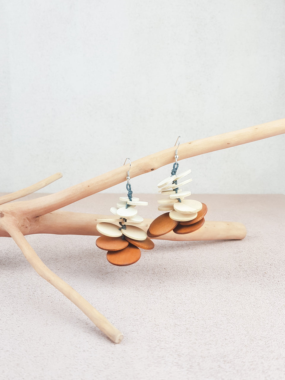 Handmade wood fish hook statement earrings in natural and brown.