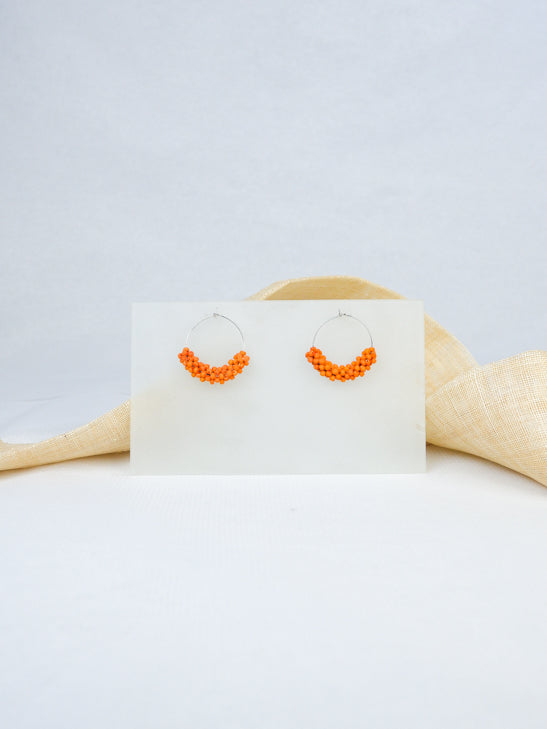Orange handmade wood hoop woven beads statement dangling earrings