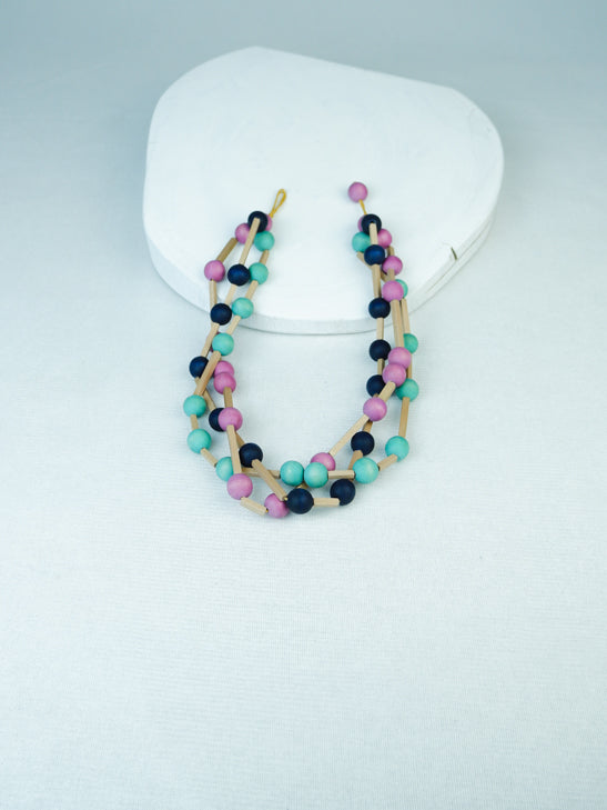 handmade 3 row geomteric wood bead necklace in blue multi