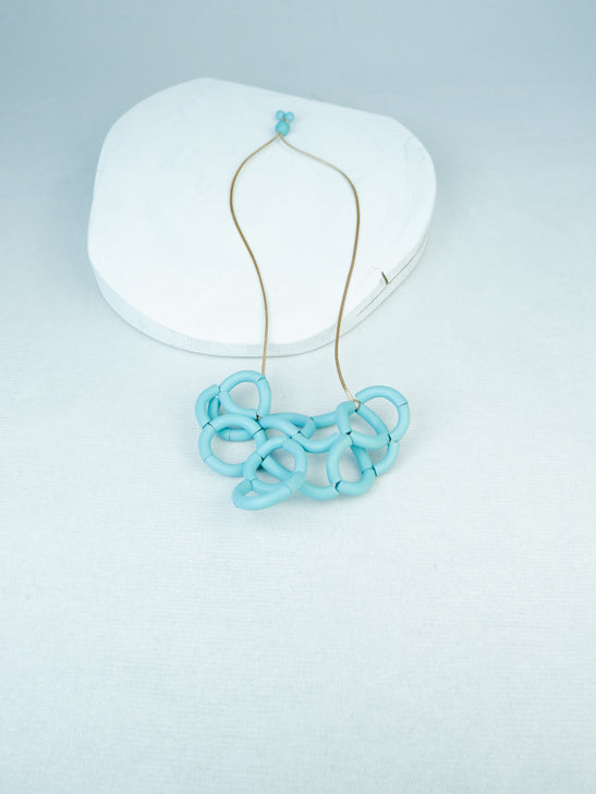 handmade wood geometric noodle necklace in sky blue
