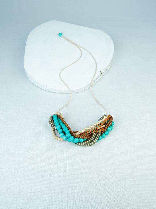 Handmade multi wood bead twist necklace  in TurquoiseMulti