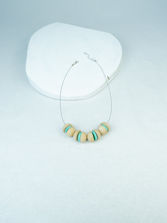 handmade geometric wood bead necklace on cable in Nautral