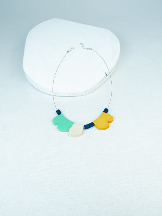 Handmade contemporary wood and acrylic necklace on cable in Turquoise multi