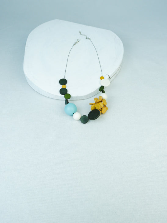 Handmade geometric wood bead necklace on cable in Yellow multi