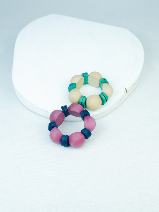 handmade wood geometric bead stretch bracelet in natural and purple