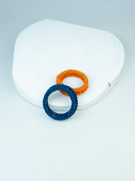 handowen bead memory wire bracelet in blue and orange