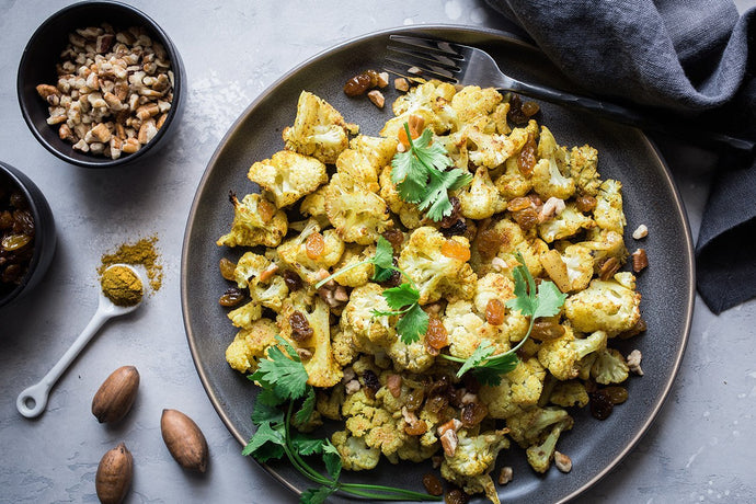Roasted Curried Cauliflower with Pecans and Golden Raisins