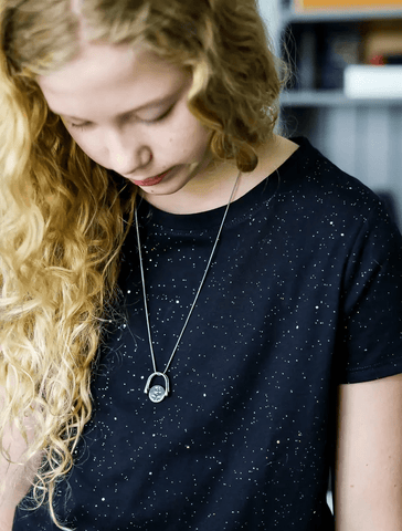 CONQUERing necklace on teen girl
