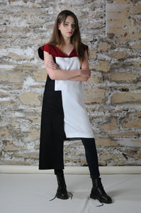 Dress shown in a casual day look with jeans and flat shoes - white black side pocket red v-neck