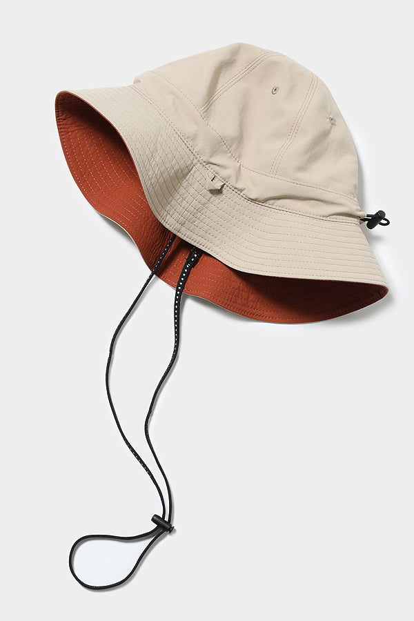 MOUN TEN. reversible adventure hat beige x tarracotta