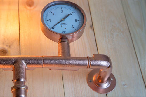 Industrial  steel pipe wall light in copper with vintage edison light bulbs