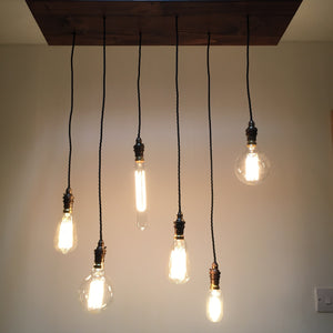 6 hanging vintage edison light bulbs, suspended from a rustic wooden base with vintage cables and old English style lamp holders